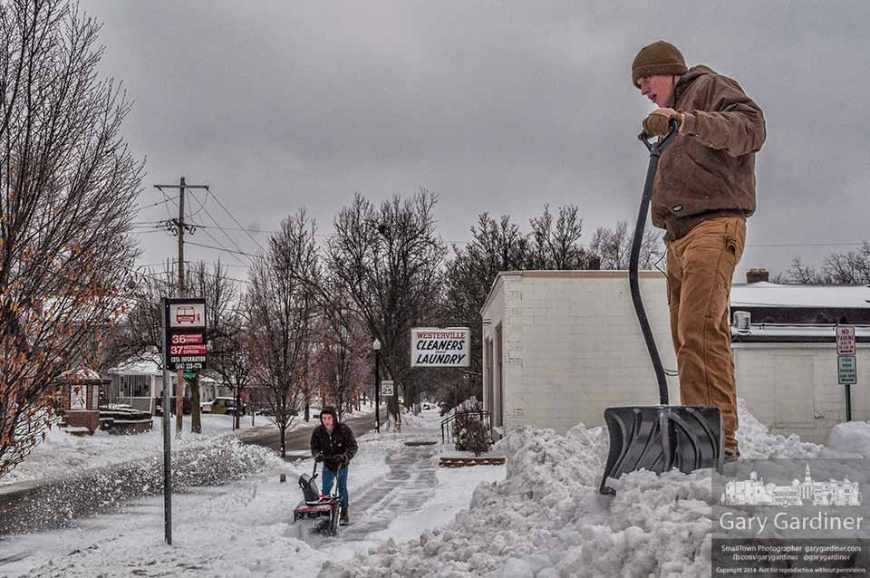 After helping clear snow from the sidewalk and parking lot for Westerville Cleaners on Main Street one of the youthful workers stands atop the mountainous mound of snow collected during the clearing. My Final Photo for Feb. 5, 2014.