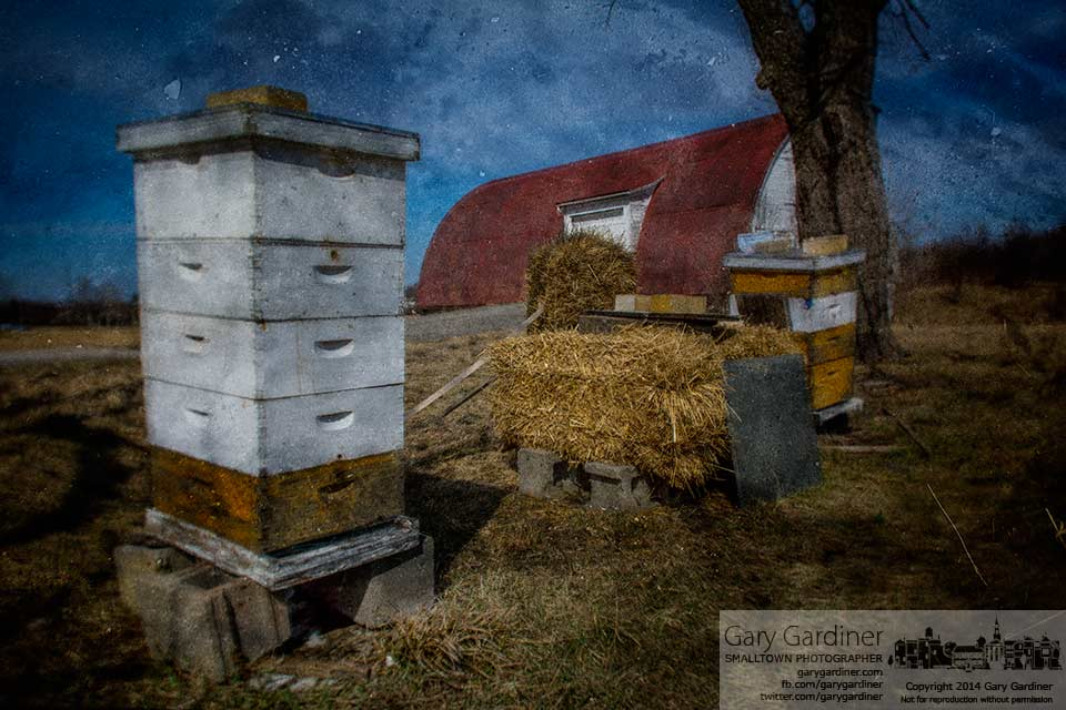 The toppled bee hive is righted, repaired, and ready for the warmth of spring at the Braun Farm barn. My final Photo for March 24, 2014.