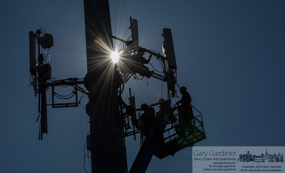 Workers install an additional cell phone antenna atop the tower inside the eastbound loop for the entrance ramp to I270 at Westerville Road. My Final Photo for March 13, 2014.