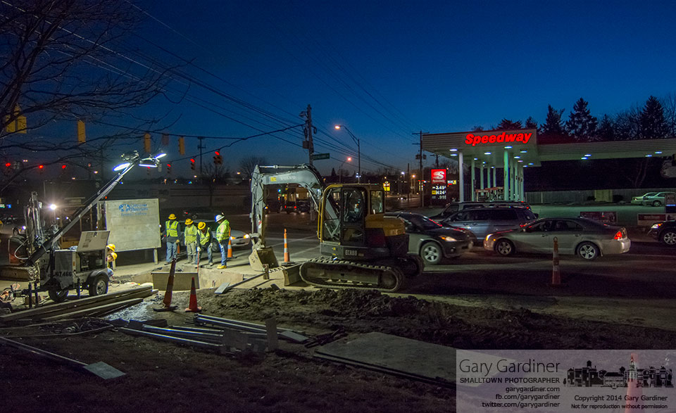 Telephone workers repair an underground cable with more than 400 individual wires that was cut during a boring operation to lay fiber optic for a business on Cleveland Ave. My Final Photo for March 7, 2014.