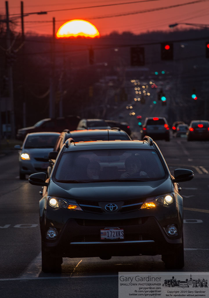 The setting sun settles below the horizon behind commuters on Schrock Road. My Final Photo for March 27, 2014.