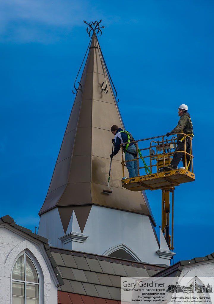 Roofers apply a sealer to a section of roof on Towers Hall at Otterbein after repair from wind damage last week. My Final Photo for March 18, 2014.