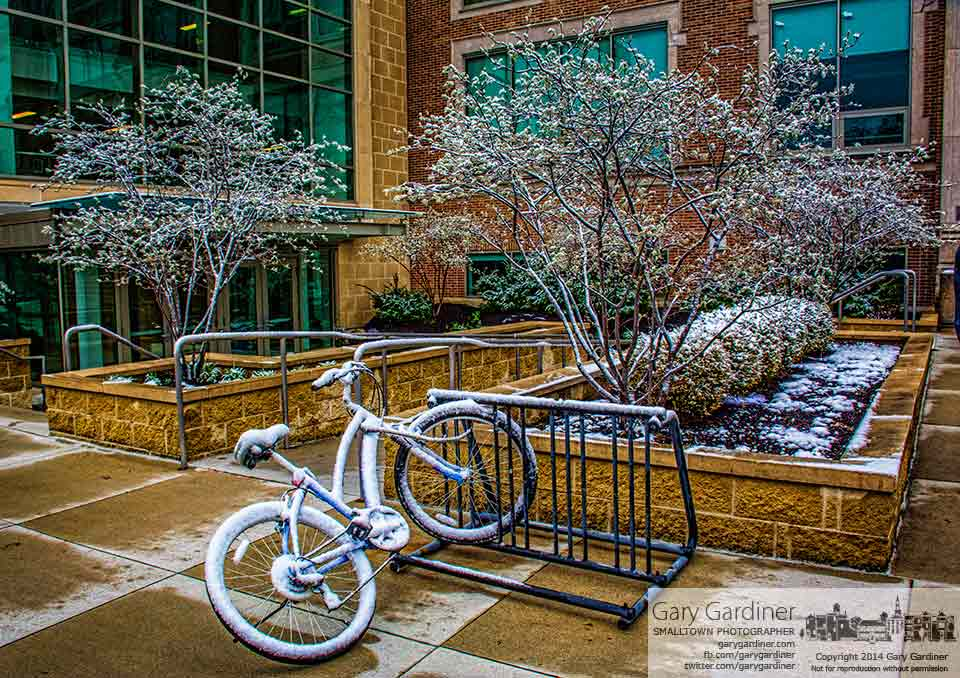 A covering of snow settled onto a bicycle parked outside an Otterbein University classroom. My Final Photo for April 15, 2015.