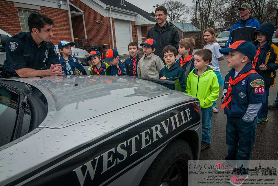 Boy Scouts on a tour of the Westerville Police Department answers questions about a police car from officer Dan Pignatelli before completing the tour inside the building. My Final Photo for April 3, 2015.