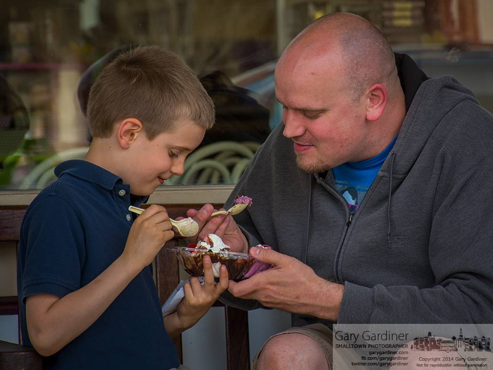 Jack Nicodemus, 7, and his father, David, enjoy a two scoop ice cream sundae on a bench in front of Graeters. My Final Photo for April 21, 2014.