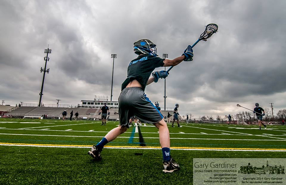 Westerville South's Lacrosse opponent warms up under cloudy skies before Friday's match at the school. My Final Photo for April 4, 2014.