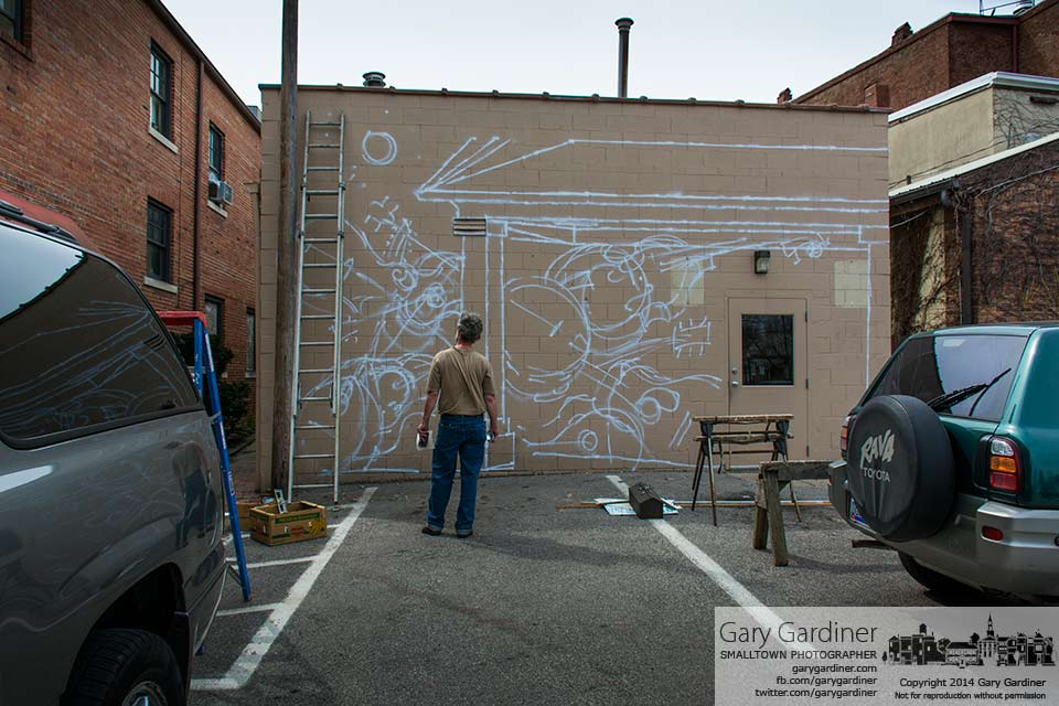 Artist Jim Saltz ponders his next move as he begins the process creating a music themed mural at the rear of 18 North State St. My Final Photo for April, 13, 2014.