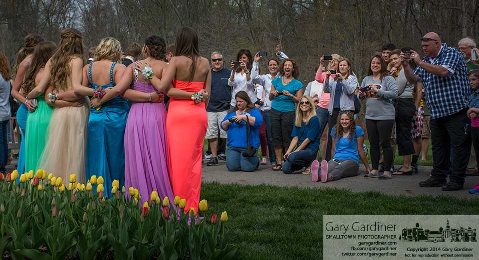 Moms and dads gather together for a group photos of some of the students gathering before prom at Westerville South and Big Walnut high schools at Inniswood Metro Garden.