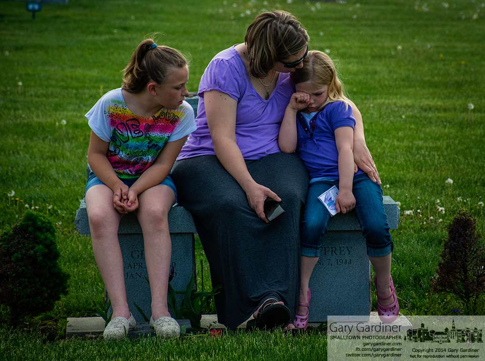A mother and her two daughters sit on a bench at the grave site of the woman's mother on Mothers Day at Blendon Cemetery. My Final Photo for May 11, 2014.
