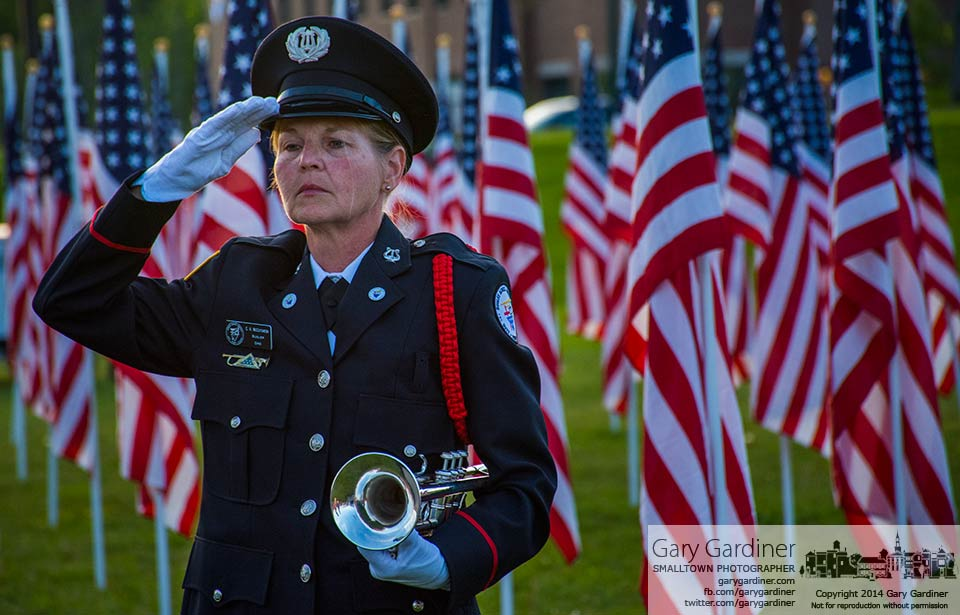 Bugler C.A. McCutcheon salutes after playing taps at sunset at the Field of Heroes in Westerville. My Final Photo for May 24, 2014.