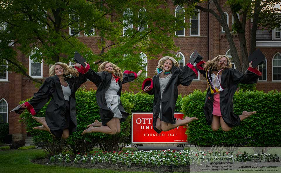 Four graduating seniors at Otterbein University leap together for a set of family photos as classes go into their final week with finals for some. My Final Photo for May 13, 2014.
