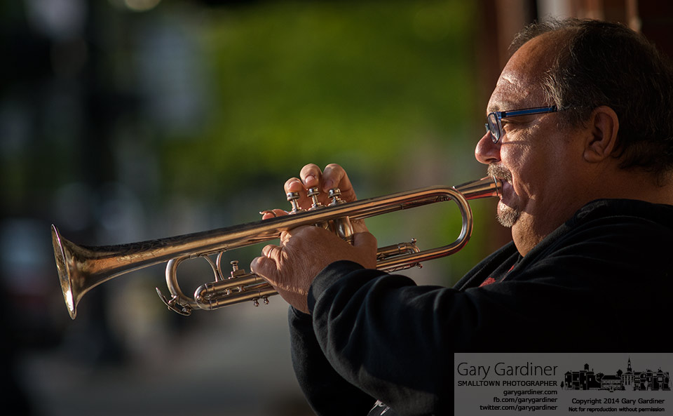 Trumpet player Steve Titus performs on State Street at sunset as part of the Unplugged Friday in Uptown Westerville. My Final Photo for May 16, 2014.