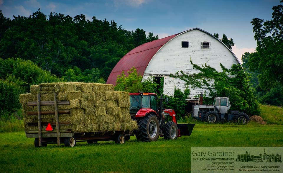 One of three loads of hay is moved to the barn on the Braun farm as the first cut of hay for Otterbein's equine program continues despite wet weather that has delayed the harvest. My Final Photo for June 23, 2014.