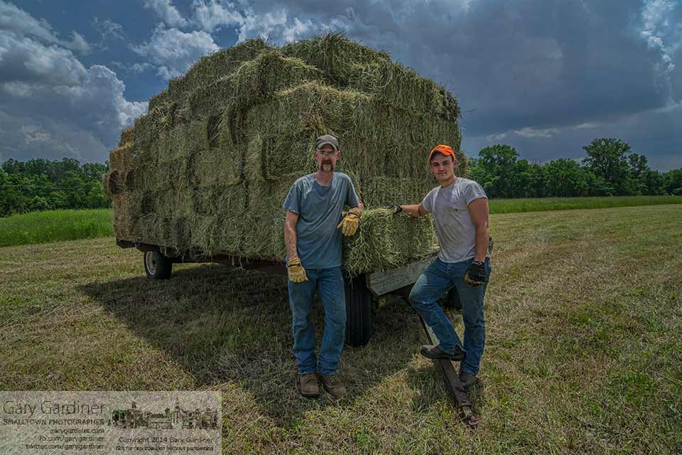 Farm hands pose for a photo after loading the last trailer of hay for the day. My Final Photo for June 18, 2014.