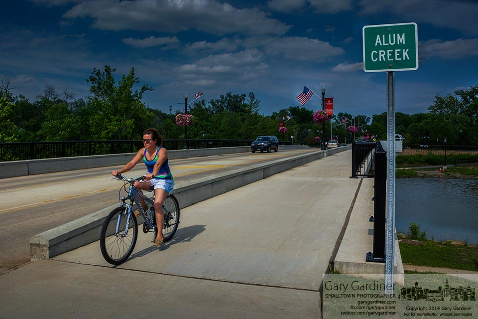 A lone bicyclist crosses the Main Street Bridge late in the afternoon of the warmest day of the year, so far. My final Photo for June 17, 2014.