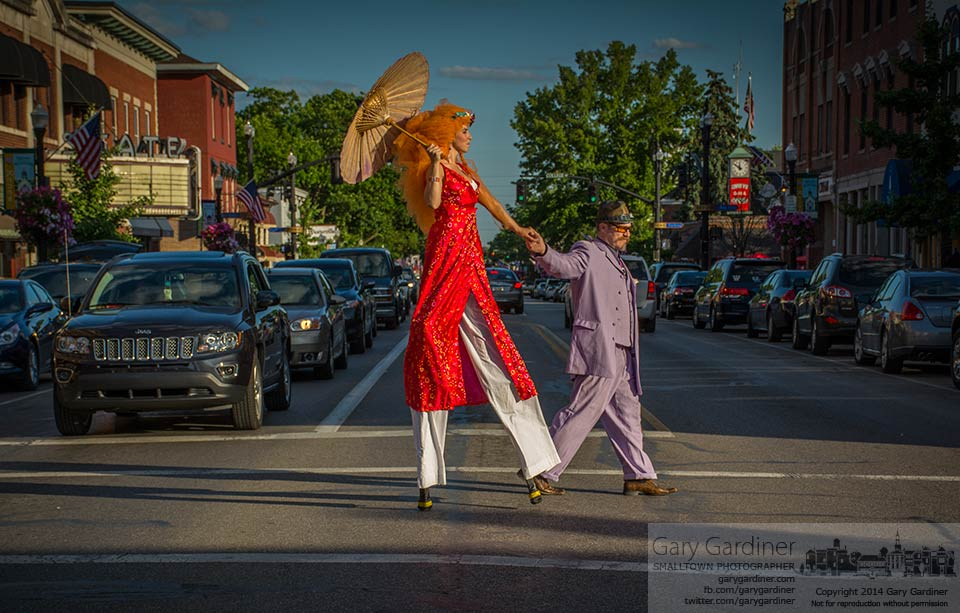 The tallest woman in Westerville and her escort for the evening cross State Street during Art in Uptown on the second Friday of the month. My Final Photo for June 13, 2014.