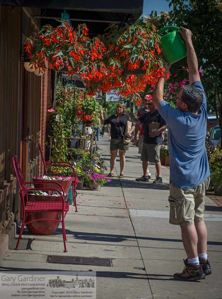 The hanging baskets in front of Old Bag o' Nails in Uptown Westerville receive their daily watering. My Final Photo for June 7, 2014.