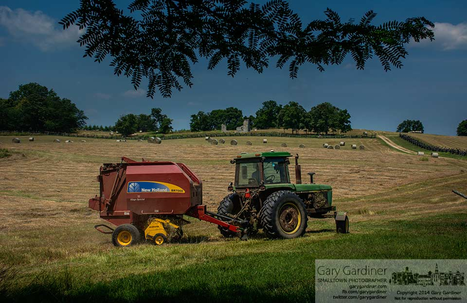 A farmer bales hay along the base of School House Ridge where Union soldiers surrendered to Stonewall Jackson in the battle for Harper's Ferry, WV. My Final Photo for July 7, 2014.