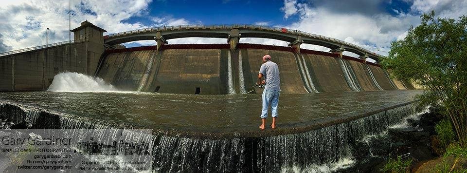 A fisherman stands on the lower spillway at Hoover Reservoir looking for his catch of the day. My Final Photo for July 13, 2014.