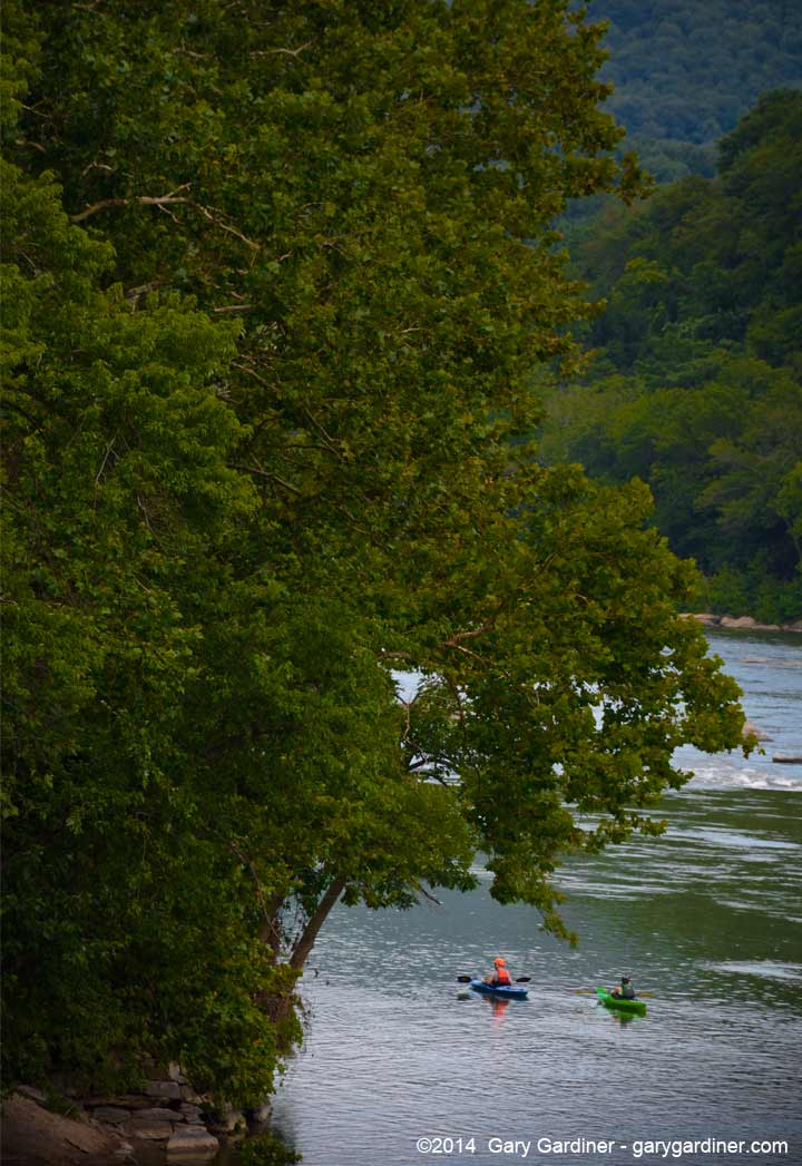 A pair of kayakers paddle into the Potomac River at the confluence of the Shenandoah River at Harper's Ferry, WV. My Final Photo for July 6, 2014.