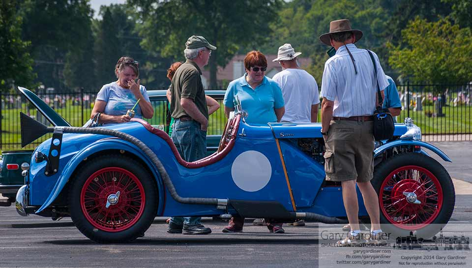 Hot rod and vintage car fans gather around a roadster displayed at the Blendon Township Car Show. My Final Photo for August. 23, 2014.