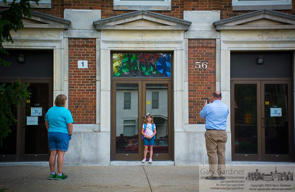 A second grader at Hanby Elementary pauses at the front door of the school for a photo by her parents on  the first day of school for Westerville. My Final Photo for August 13, 2014.