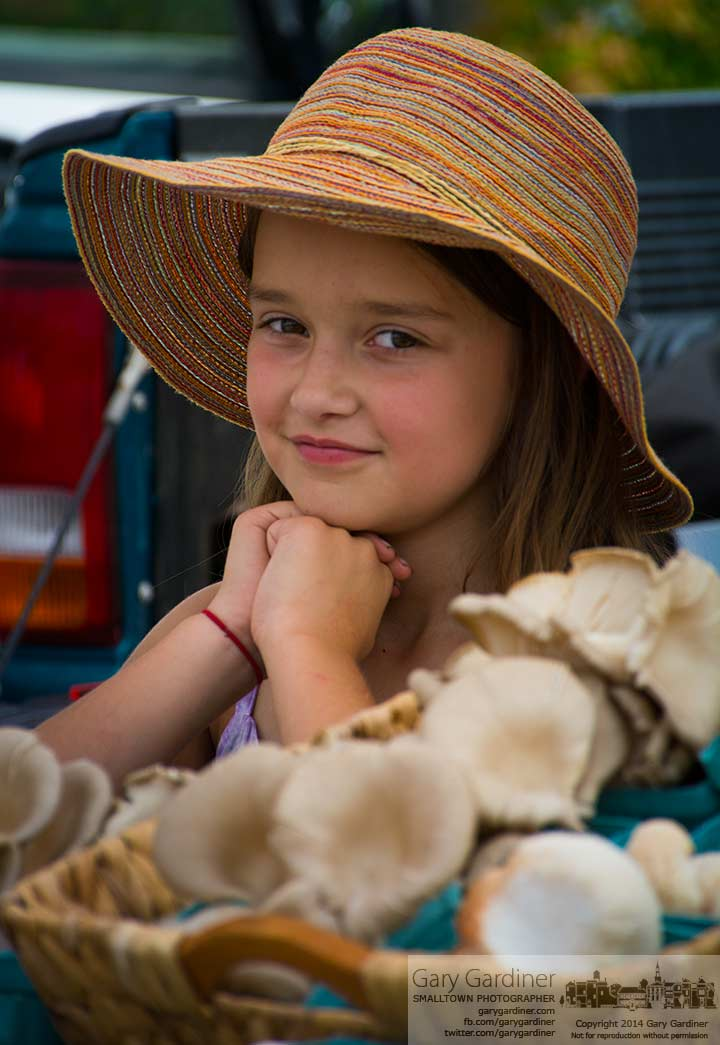 One of the youngest vendors tends her family's stand of mushrooms at the Uptown Westerville Farmers Market. My Final Photo for August 6, 2014.