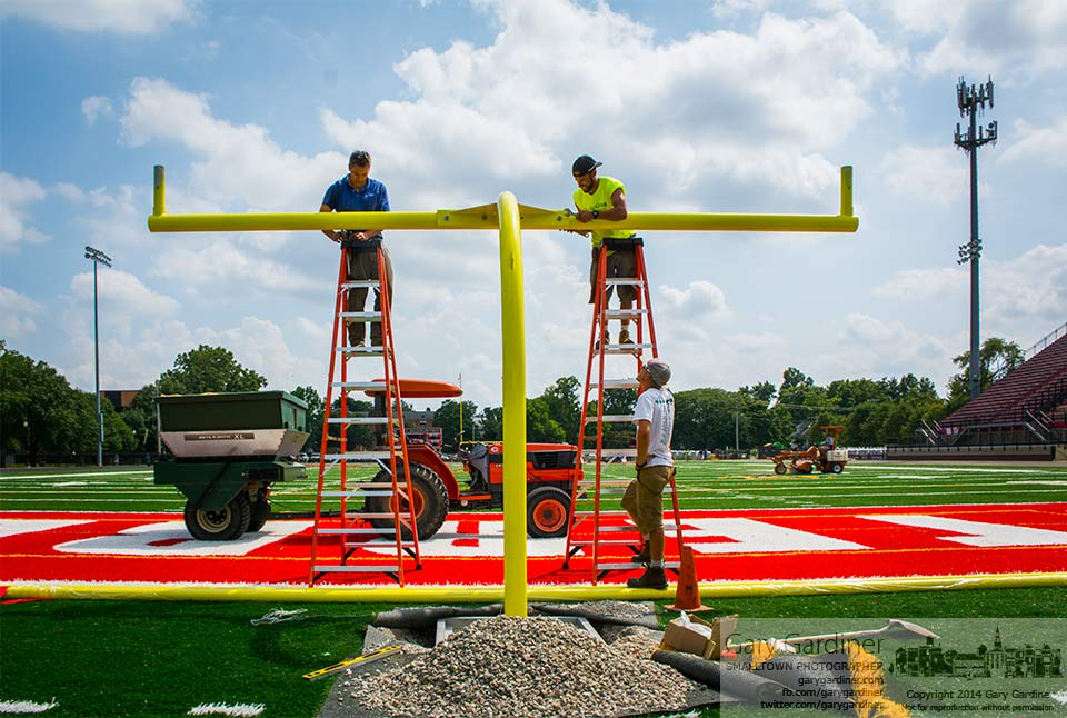 Workers install the cross member of the second goal post installed on the rebuilt football field at Otterbein University. My Final Photo for August 27, 2014.