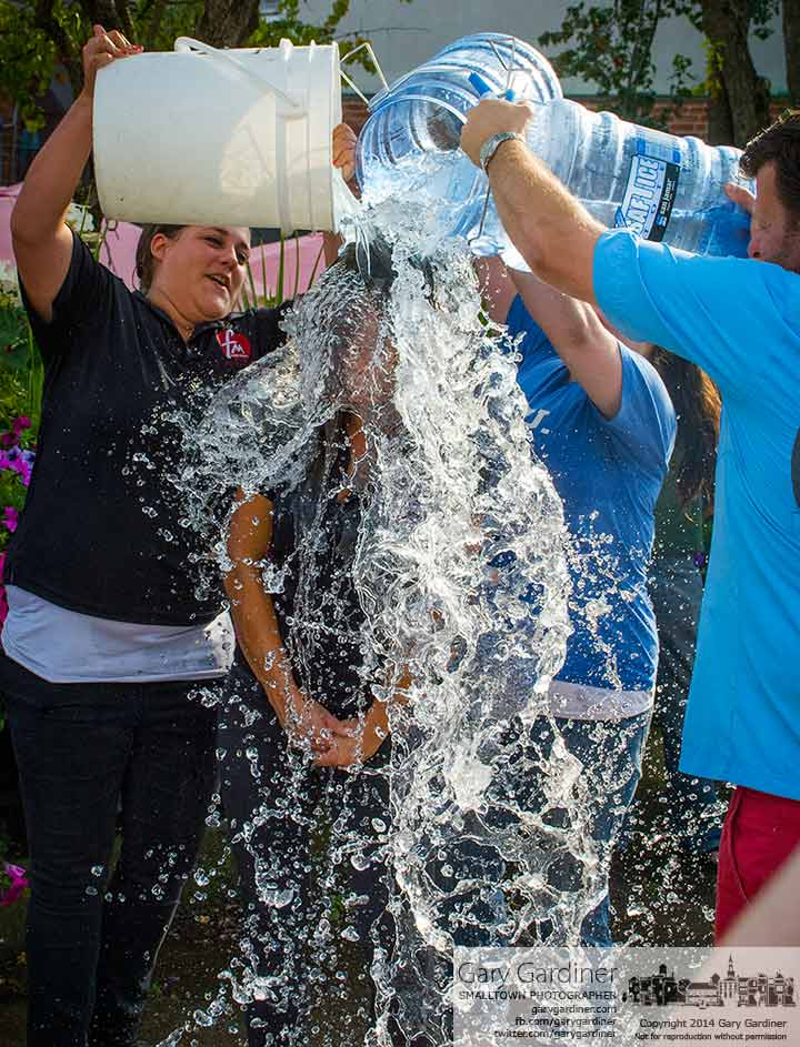 Jessica Zardain gets three buckets of ice water dumped over her head by her boss and coworkers on the sidewalk outside Jimmy V's as her contribution to the ALE ice bucket challenge. My Final Photo for August 19, 2014.