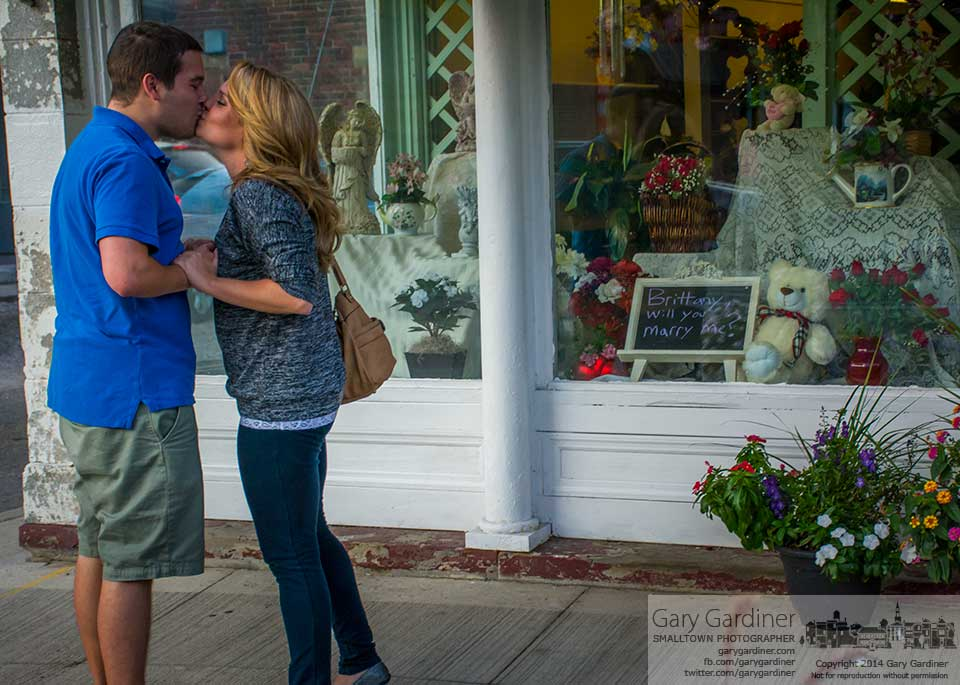 Pat and Brittany kiss in front of the Westerville Florist window he had decorated as part of his marriage proposal. My Final Photo for August 15, 2014.