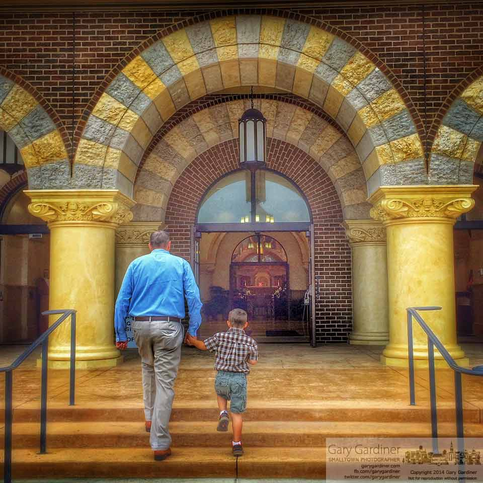A father and son enter St. Paul Catholic Church for morning Mass through doors opened after the air conditioning failed. My Final Photo for August 24, 2014.