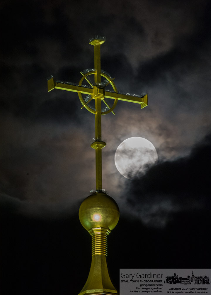 The supermoon rises behind a cloud layer over St. Paul Church's steeple. My Final Photo for August 10, 2014.