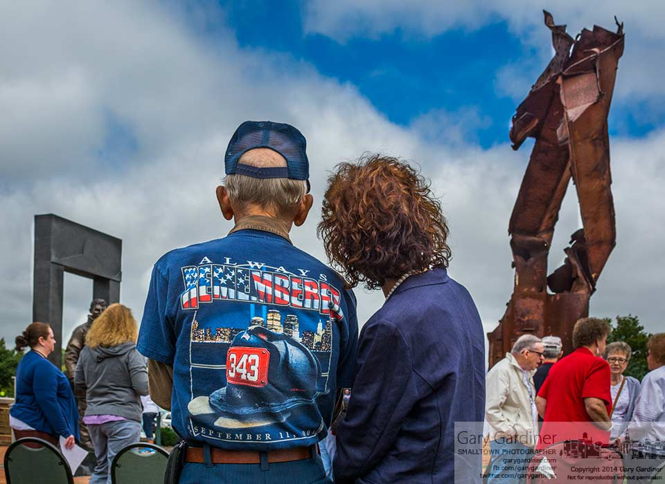 A retired Columbus fire fighter and his wife stand together after a 9/11 memorial service at First Responders Park in Westerville. My Final Photo for Sept. 11, 2014.