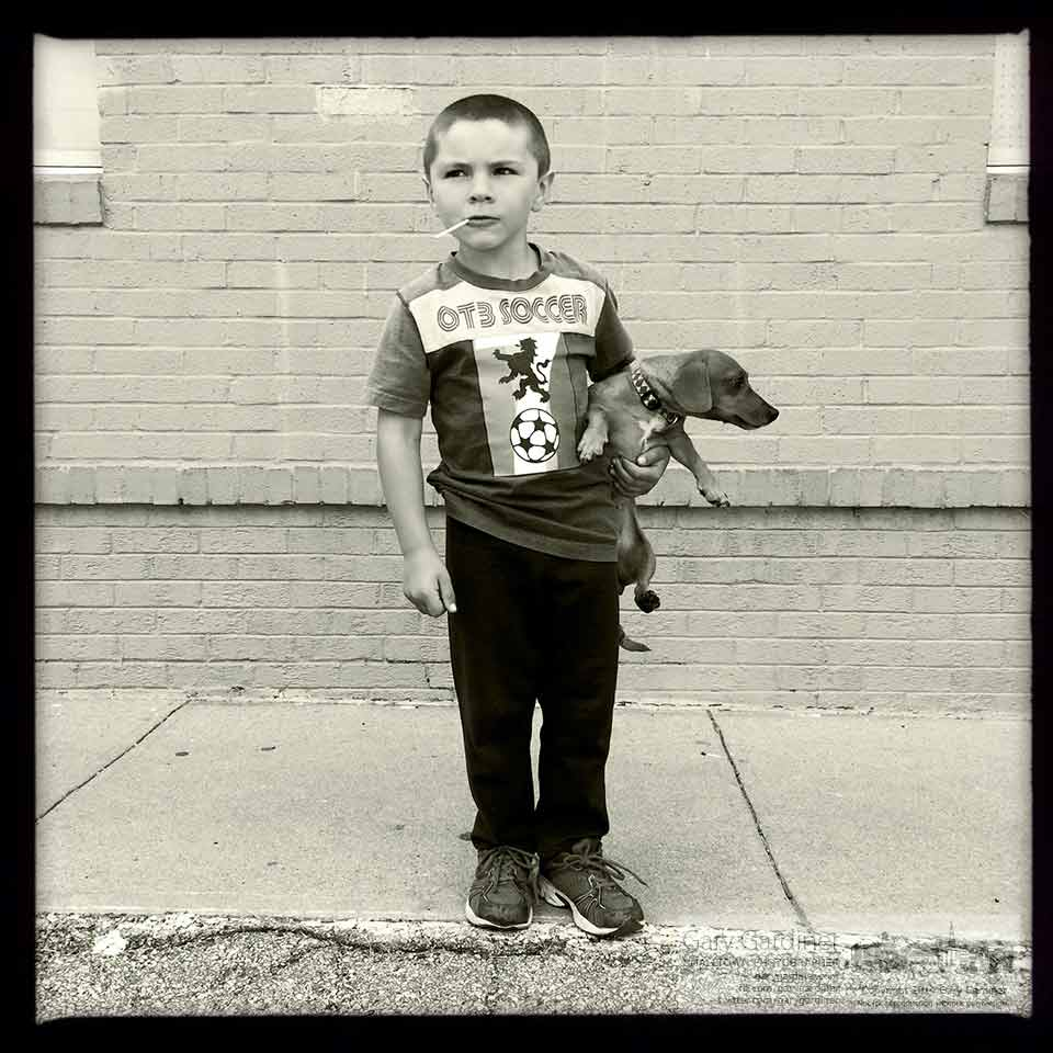 Jonathan stands with his dog, Snickers, outside Troyer's in Johnstown as his farmer father delivers vegetables to the store. My Final Photo for Sept. 17, 2014.