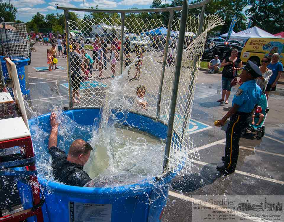 Westerville police officer Ron McMilliin splashes into the dunk tank at the hands of a youngster at Cops and Kids Day at Hoff Park. My Final Photo for Sept. 7, 2014.