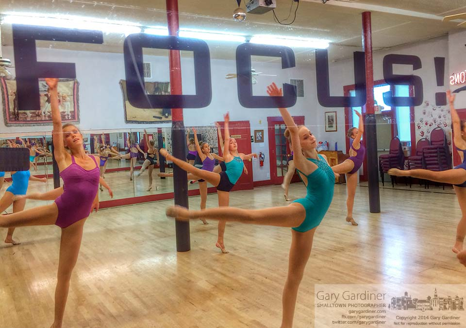 Dancers at Generations Performing Arts Center practice in front of a full-length mirror with words designed to help them with technique, style, and attitude in their performances. My Final Photo for Sept. 2, 2014.