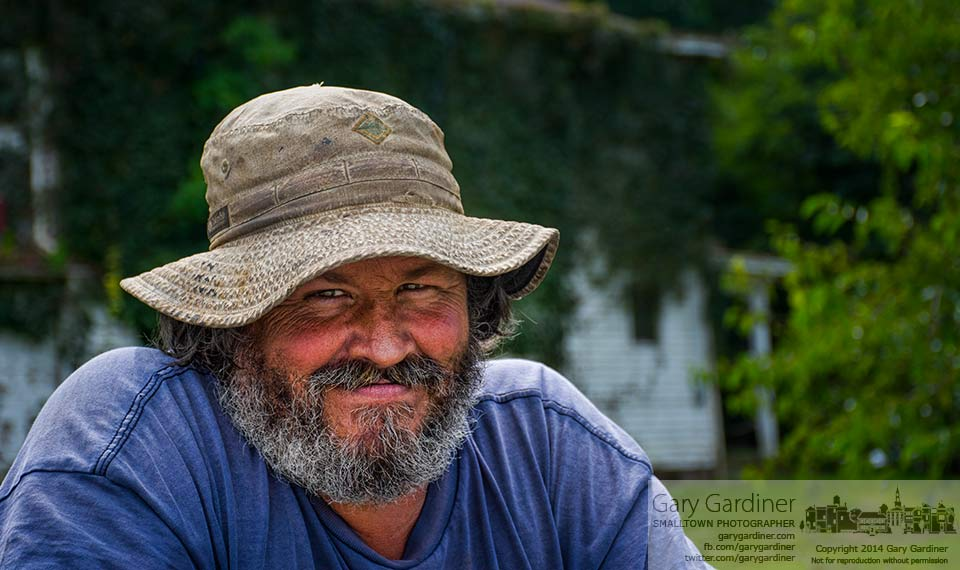 Mark, one of the farmers who tends the Braun Farm property, relaxes on the bed of his pickup during a break cutting grass and trimming weeds at the farm on Cleveland Ave. My Final Photo for Sept. 8, 2014.