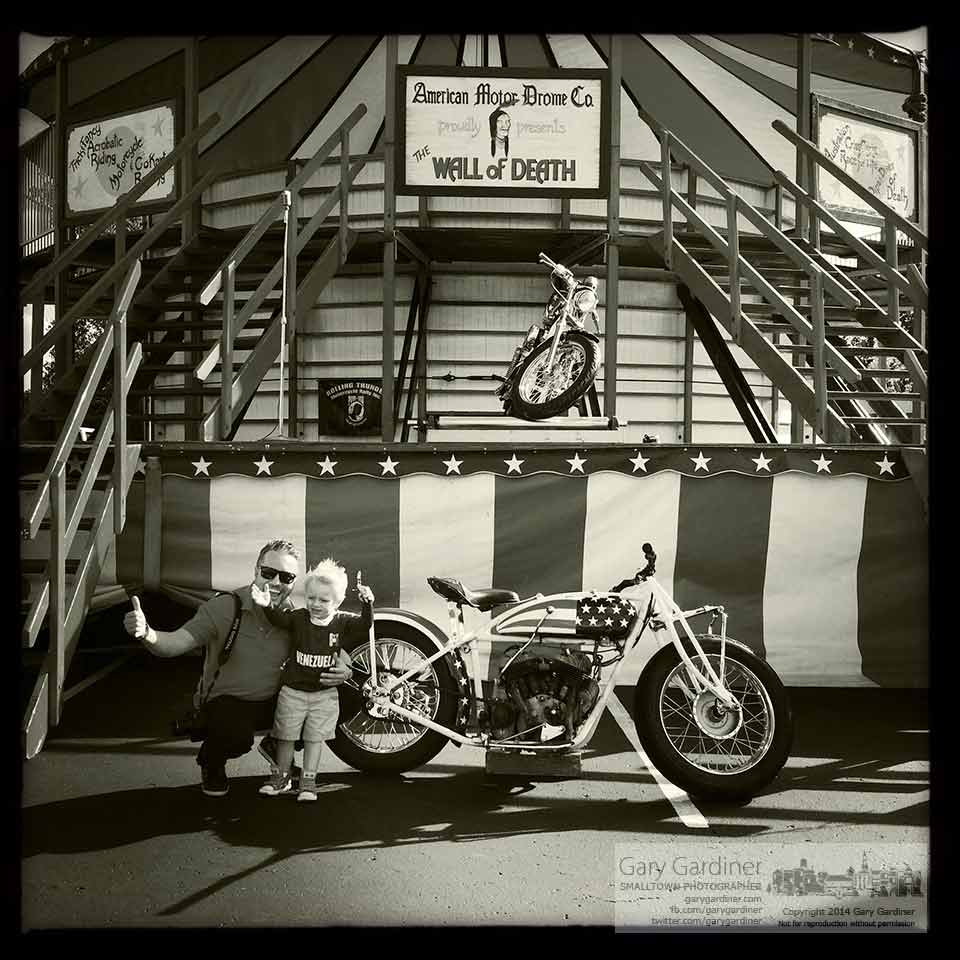 A father and son give a thumbs up while posing with a photo at the American Motor Dome Wall of Death at Iron Pony near Westerville. My Final Photo for Sept. 21, 2014.
