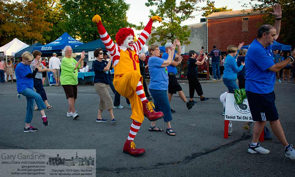 Ronald McDonald mimics the Taoist Tai Chi Society demonstrating their technique to the crowd at Fourth Friday. My Final Photo for Sept. 26, 2014.