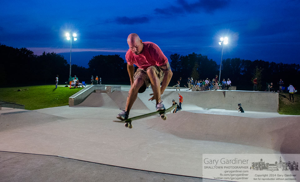 A skater floats above the bowl at Westerville Skate Park on  the annual Late Night Skate when the park is lit by portable lights. My Final Photo for Sept. 20, 2014.