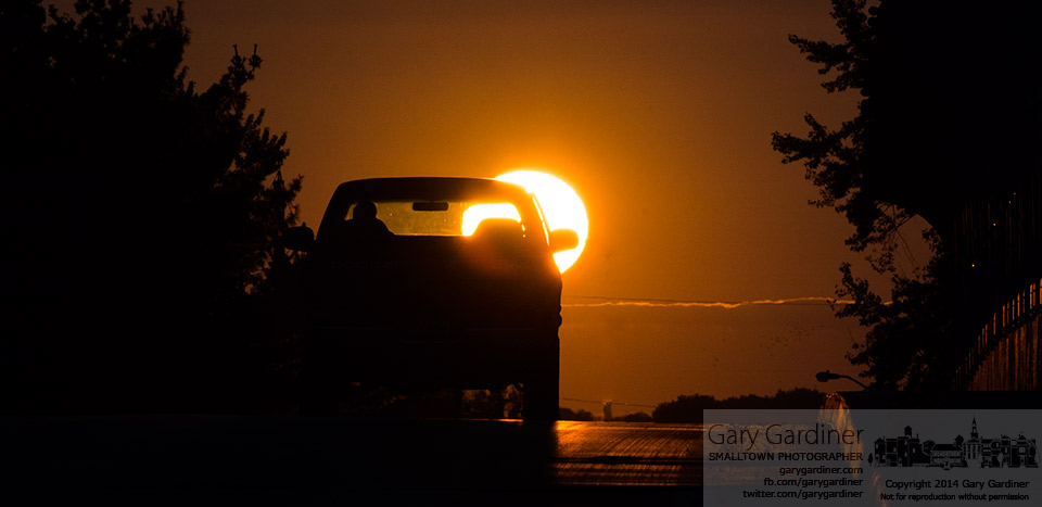A driver navigates into the sunset as he crosses the Dempsey road bridge over I-270. My Final Photo for Sept. 16, 2014.