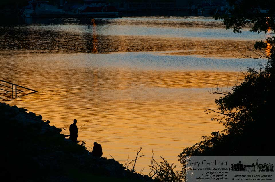 Fishermen are silhouetted against the sunset along the rocks at Hoover Dam. My Final Photo for Sept. 14, 2014.