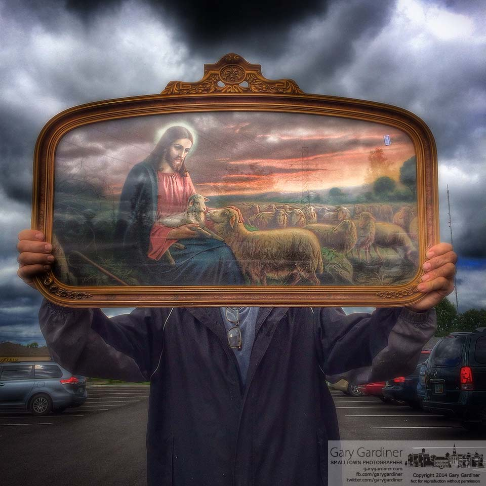 A customer displays the Christian print and gold frame he bought at a thrift store in Westerville. My Final Photo for Sept. 13, 2014.