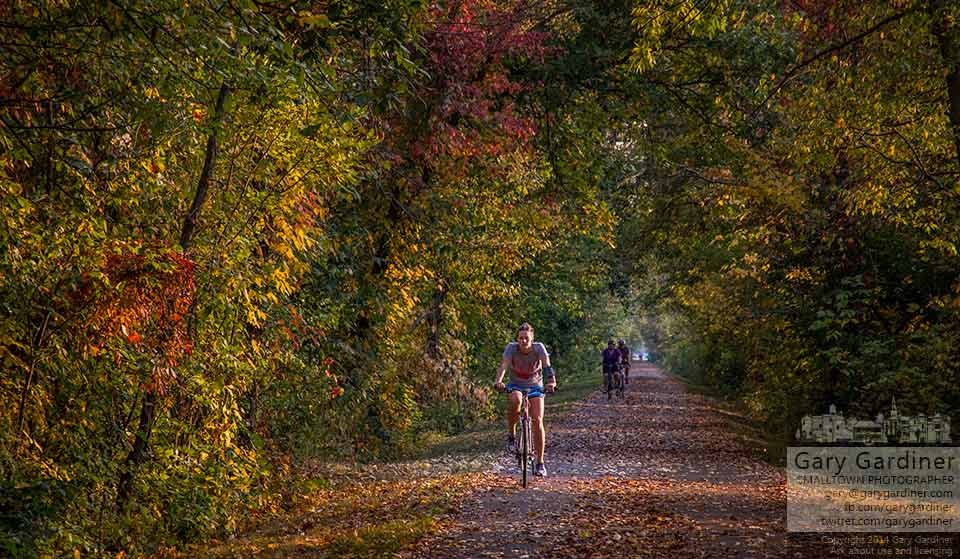 Bicyclists enjoy the early fall colors along the bike path north of Westerville on a warm afternoon. My Final Photo for Oct. 2, 2014.