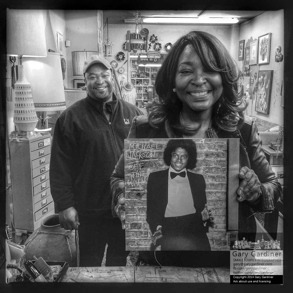 Carlita holds the Michael Jackson vinyl album she bought to give to her sister whose original album she broke stepping on it when the were teenagers. Behind her is husband, Craig.  My Final Photo for Oct. 10, 2014.