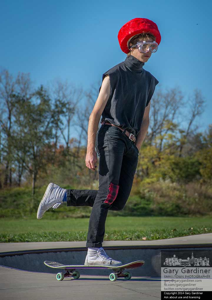 A skater dressed as Devo glides around the bowl at Westerville Skate park during HalloWesty, the costumed skateboarder competition at the park. My Final Photo for Oct. 26, 2014.