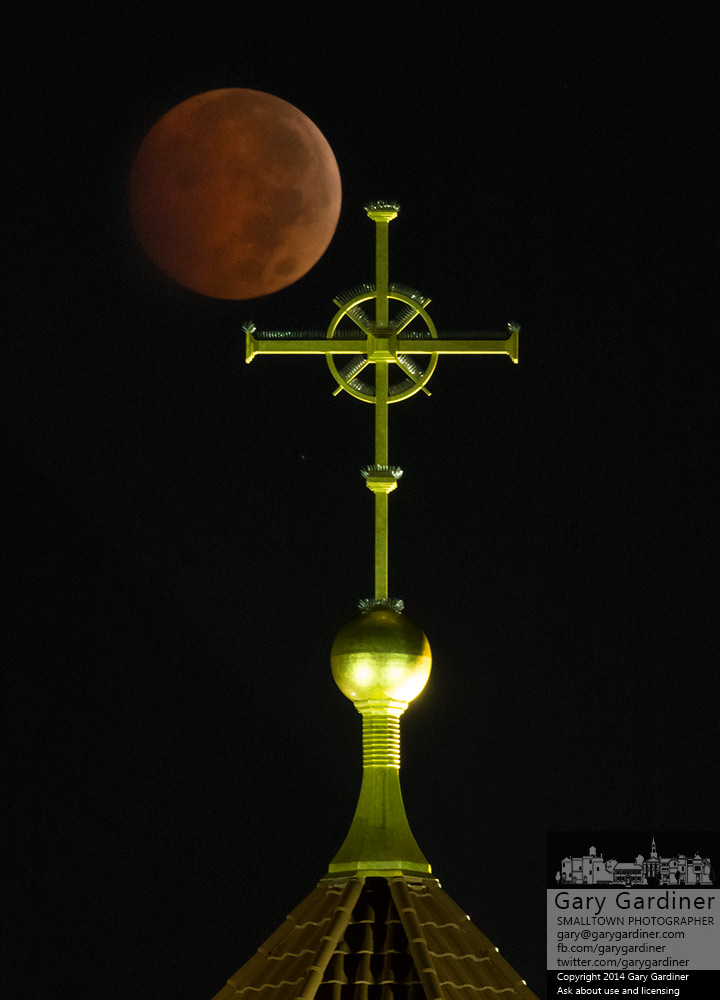 The blood moon sets behind the cross atop St. Paul the Apostle Catholic Church in Westerville. My Final Photo for Oct. 8, 2014.