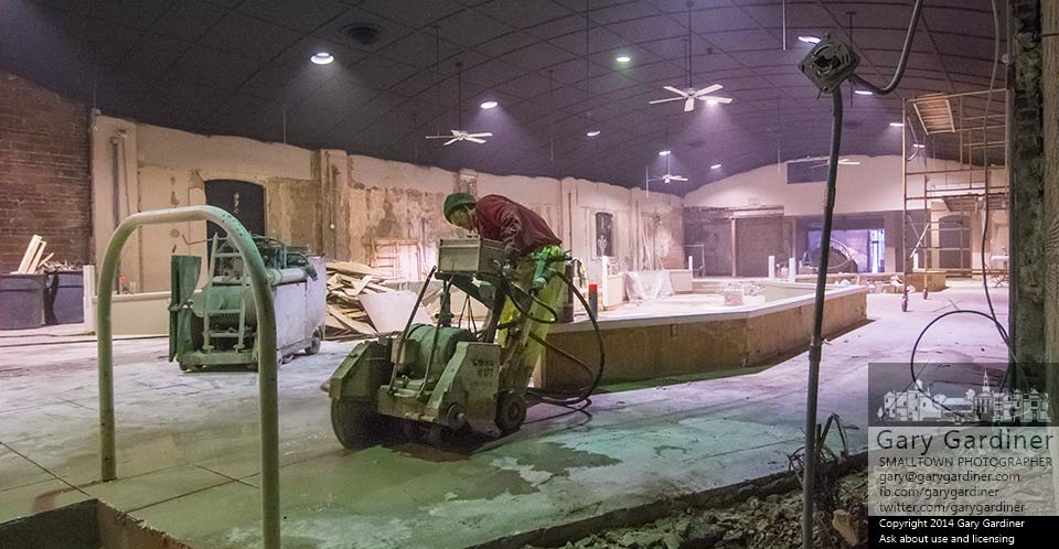 A concrete cutter makes the last slices into the stage floor in the State Theater to make room for gas and water line improvements where the 8 State Bistro kitchen will be built. My Final Photo for Nov. 19, 2014.
