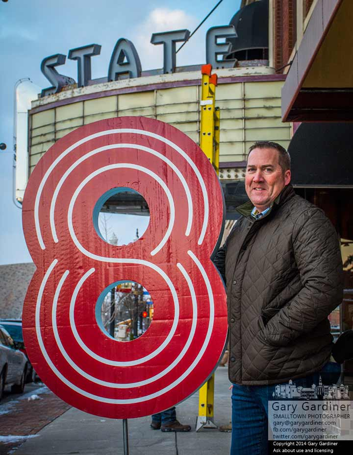Kevin Campbell, owner of 8 State Bistro, stands with the mockup sign used to demonstrate to the Uptown Review Board how the neon number will look once it is placed atop the theater marquee when the restaurant opens. My Final Photo for Nov. 20, 2014.