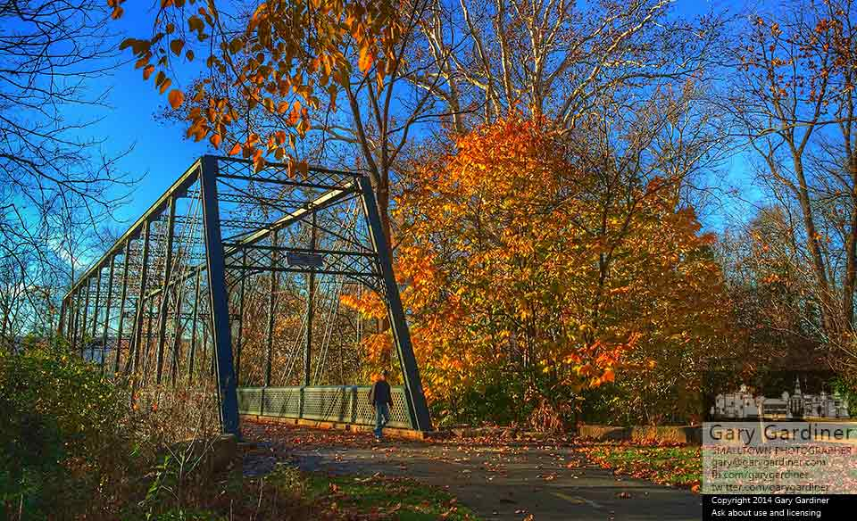 A man crosses the old Beach Road Bridge over Alum Creek along the western edge of the Westerville bike path that parallels the creek. My Final Photo foe Oct. 2, 2014.